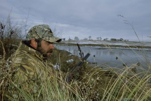 Men_in_camouflage_hunting_gear